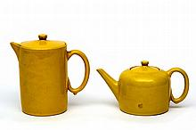 Metz & Co. A yellow glazed ceramic teapot and a c