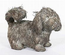Een zilveren model van een hondje, Gianmaria Bucc