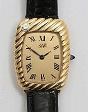 Longines golden watch.