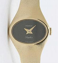 Tissot golden watch.