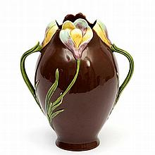 Julius Dressler  A red glazed ceramic vase moulded with a pattern of flowers, circa 1900, signed