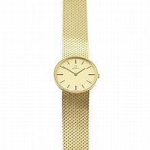Men's Zenith Wristwatch, circa 1970's; case #60 0200 180; 17 jewel unadjusted movement; in an 18k yellow gold case with an integral 18k yellow gold mesh strap