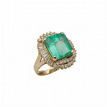 18k Yellow Gold Ring, set with a large emerald cut emerald (approx. 13.60ct.) encircled by 26 baguette cut and 24 brilliant cut diamonds (approx. 1.80ct.t.w.)
