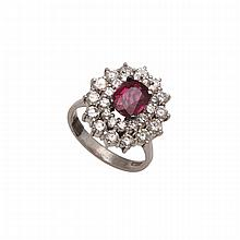 Platinum Ring, set with a cushion cut ruby (approx. 1.70ct.) encircled by 28 brilliant cut diamonds (approx. 1.90ct.t.w.)