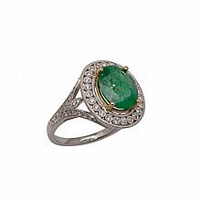 18k White And Yellow Gold Ring, set with an oval cut emerald (approx. 3.07ct.) in a mount decorated with 92 small brilliant cut diamonds