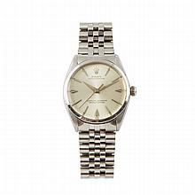 Rolex Oyster Perpetual Wristwatch, circa 1962; reference #1002; case #837691; movement #D49809; 26 jewel cal.1560 automatic movement adjusted to temperature and 5 positions; in a stainless steel case with stainless steel strap and deployant buckle