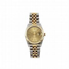 Rolex Oyster Perpetual Datejust Wristwatch, circa 1993; reference #16233; case #S926293; movement #6951352; 31 jewel cal.3135 automatic movement adjusted to temperature and 5 positions; brushed gold dial; in a stainless steel case and strap with gold