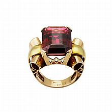 18k Yellow And Rose Gold Ring, set with an emerald cut rubellite tourmaline (approx. 18.0ct.)