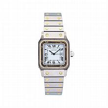 Cartier Santos Automatic Wristwatch With Date, case #296193223; automatic wind movement; in a stainless steel case and strap with gold bezel and trim, and a sapphire crown