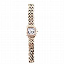 Lady's Geneve Wristwatch, circa 1990's; quartz movement; in a 14k yellow gold case set with 28 small brilliant cut diamonds, with a 14k yellow gold grain de riz strap and deployant buckle