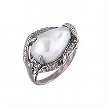 14k White Gold Ring, set with a large baroque pearl and decorated with 23 small single cut diamonds