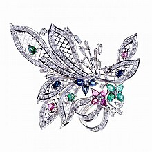 18k White Gold Spray Brooch, set with 14 baguette cut and 112 brilliant cut diamonds (approx. 1.50ct.t.w.) and decorated with small pear cut sapphires, rubies, emeralds and tsavorite garnets