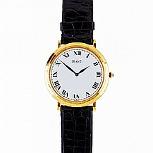 Piaget Wristwatch, circa 1980's; reference #902; case #232197; movement #7310493; 18 jewel cal. 9P movement adjusted to temperature and 5 positions; in an 18k yellow gold case, with a leather strap with an 18k gold buckle