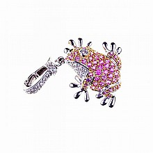 18k Yellow And White Gold Pendant, formed as a frog and set with 55 small full cut rubies, and decorated with 24 small brilliant cut diamonds