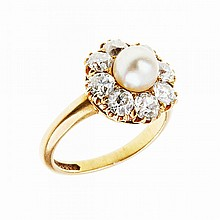 Ryrie Bros. 18k Yellow Gold Ring, set with a pearl (6.8mm) encircled by 8 old European cut diamonds (approx. 2.30ct.t.w.)