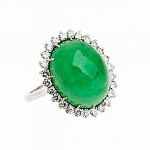 18k White Gold Ring, set with an oval jadeite cabochon (15.8mm x 12.8mm x 6.8mm) encircled by 26 brilliant cut diamonds (approx. 0.65ct.t.w.)