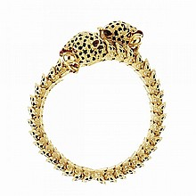 Italian 18k Yellow Gold Cross-Over Bracelet, terminated in two leopard heads and decorated with enamel
