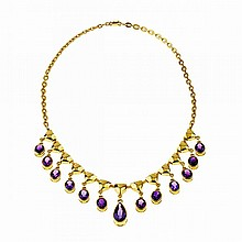 14k Yellow Gold Fringe Necklace, suspending a pear cut and 12 oval cut amethysts