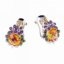 Pair Of 18k White And Yellow Gold Earrings, each set with a round fancy cut citrine in a mount decorated with small full cut diamonds, yellow sapphires, rubies and tsavorite garnets