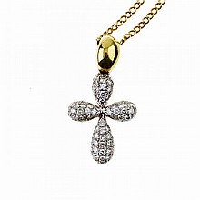 18k White And Yellow Gold Cross Pendant, set with 78 small brilliant cut diamonds, and suspended on an 18k yellow gold curb link chain