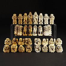 Japanese Carved Ivory Nesuke Type Figural Chess Set signed Tomomitsu, 19th or early 20th century, king height 3