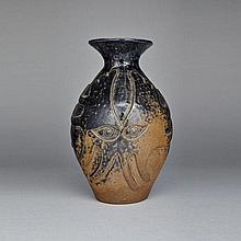 EVOO SAMGUSAK MANGELIK (1942-), VASE WITH OPPOSING OWLS, ceramic, height 10.25