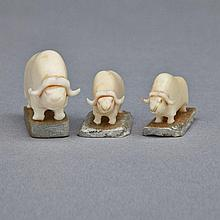 MARK TUNGILIK (1913-1986), GROUP OF THREE MUSK OXEN, ivory, stone, .75