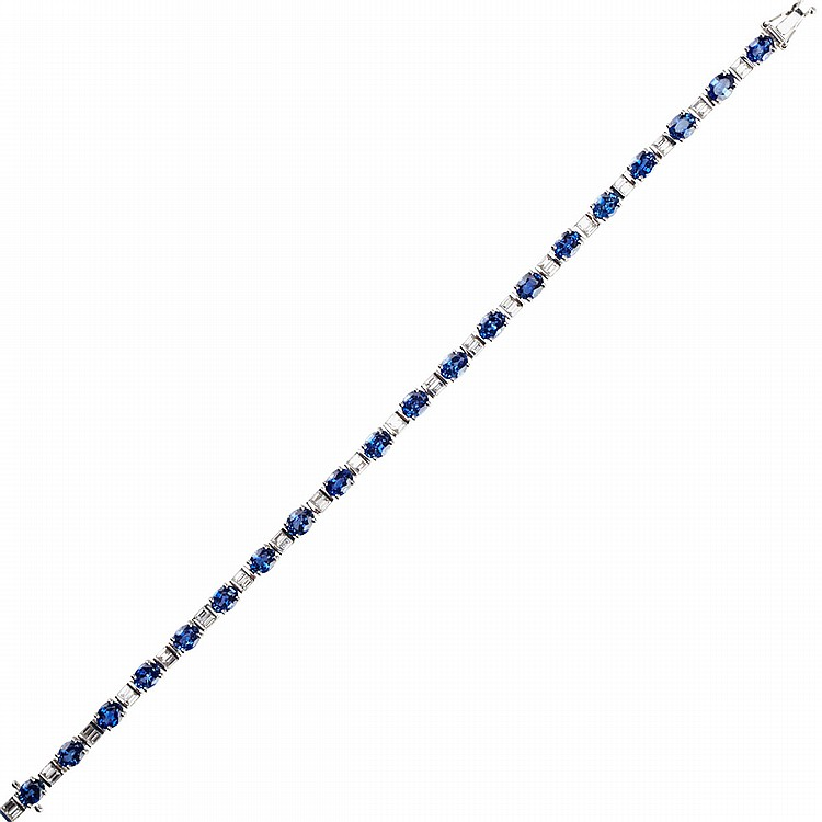 18k White Gold Straightline Bracelet set with 20 oval cut sapphires (approx. 7.20ct.t.w.) alternating with 40 baguette cut diamonds (approx. 1.20ct.t.w.), length 7
