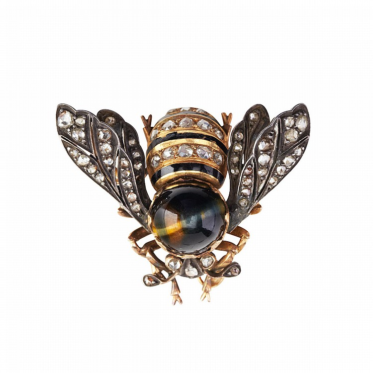 French 18k Rose Gold And Silver Brooch realistically formed as a bee, set with a tiger-eye thorax, and decorated with numerous small rose cut diamonds and enamel, 18.7 grams, one small diamond missing; pin detachable