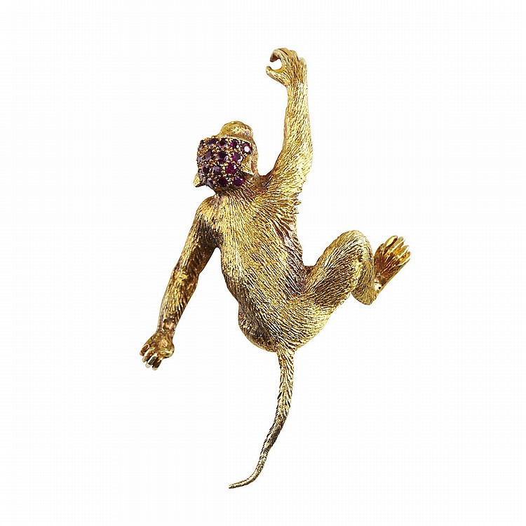 18k Yellow Gold Brooch whimsically formed as a climbing monkey, set with 20 small rubies and 2 small diamond eyes, 18.1 grams