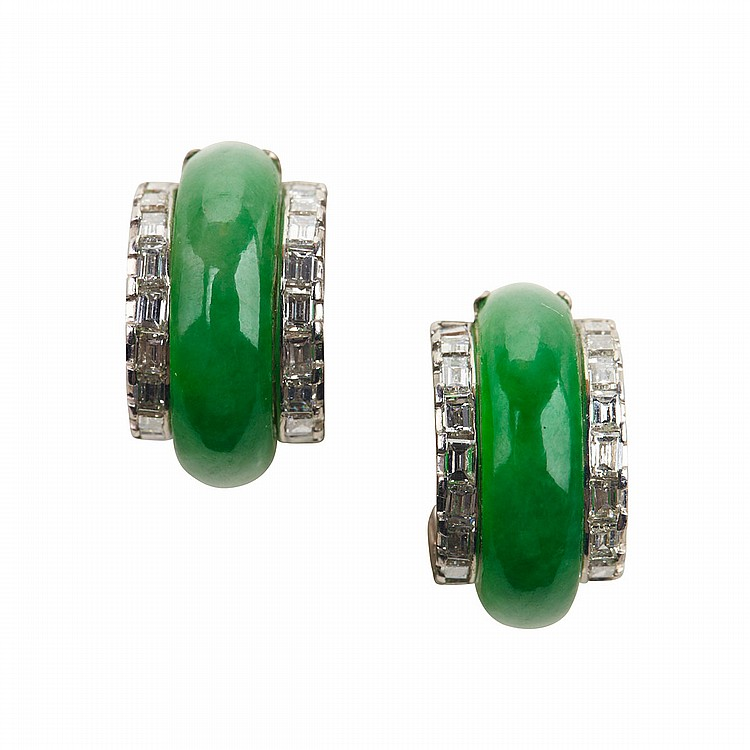 Pair Of Low Karat White Gold Earrings each set with an arched jadeite cabochon flanked by 22 baguette cut diamonds (approx. 0.75ct.t.w. per earring), 8.2 grams, marked