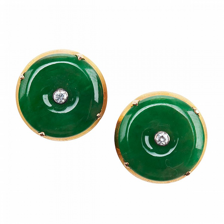 Pair Of 14k Yellow Gold Button Earrings each set with a circular jadeite disc centering a small brilliant cut diamond