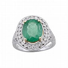 18k White And Yellow Gold Filigree Ring, set with an oval cut emerald (approx. 3.07ct.) in a mount decorated with 92 small brilliant cut diamonds