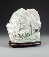 A Chinese White and Green Jade Boulder