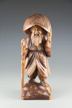A Korean Wood Sculpture of Kim Satgat