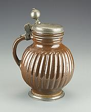 A Ceramic Beer Stein with Brown Glaze
