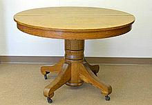 An American Oak Pedestal Table