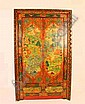 An Antique Tibetan Cabinet extensively decorated figures and animals two doors above two frieze drawers. 19th C. H.2030mm. W.1230mm D. 480mm