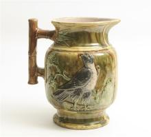 A Majolica Jug decorated with Birds