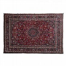 A MESHED CARPET, EAST PERSIA, MODERN the burgundy-red field with a black fl