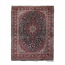 A KESHAN CARPET, PERSIA, MODERN the dark indigo field with a red and ivory
