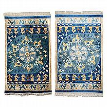 A PAIR OF CHINESE SILK RUGS, MODERN the blue field with a round medallion,