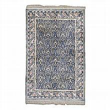 A CHINESE NEPALESE SILK CARPET, MODERN the ivory field with an overall desi