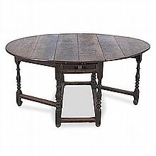 AN OAK GATE-LEG TABLE, 19TH CENTURY the rectangular top with hinged drop si
