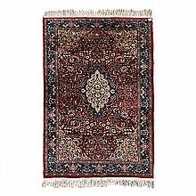 AN INDO-PERSIAN RUG, MODERN the dark red field with a green and ivory flora