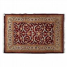 AN INDO-PERSIAN CARPET, MODERN the madder-red field with an overall design