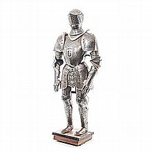 A SUIT OF ARMOUR comprising: a closed helmet, breast and back plate, faulds
