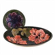 A MOORCROFT 'HIBISCUS' PATTERN DISH, 1950's oval, green ground, painted ini
