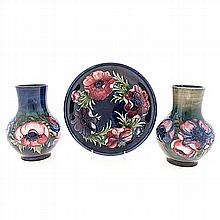 A GROUP OF THREE MOORCROFT 'ANEMONE' PATTERN WARES, 1950s comprising: 2 vas