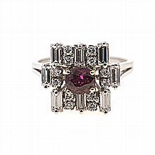 A RUBY AND DIAMOND RING the abstract design constructed by eight baguette-